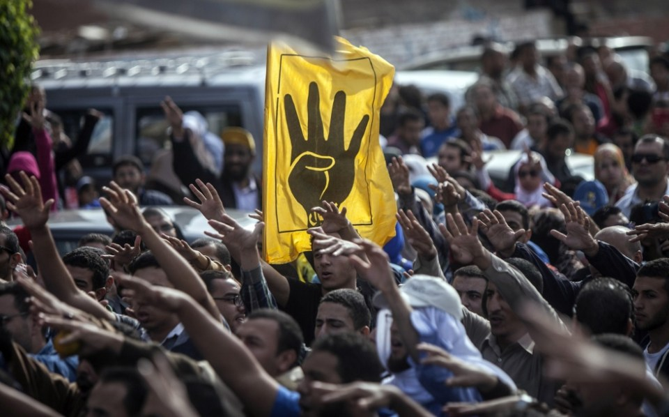 Supporters of the Muslim Brotherhood rally in Cairo in early 2014 (AFP/File)