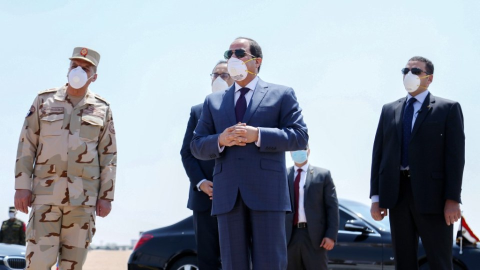 Egyptian President Abdel Fattah al-Sisi wears a protective face mask while visiting a military base east of Cairo on 7 April (Egyptian Presidency/AFP)