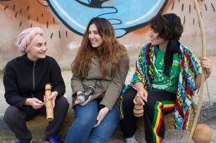 Capoeira players Daniah and Kasandra meet artist Yara Hindawi after their performance [photo: Maria de la Guardia]