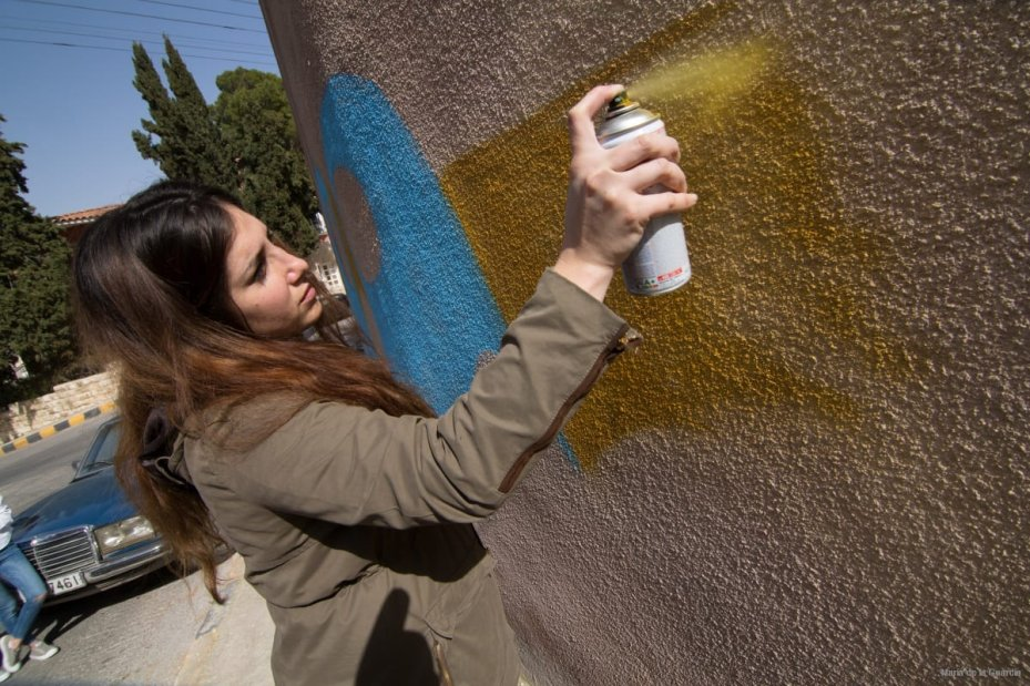 Yara Hindawi as she makes her graffiti in Jabal Weibdeh, Amman [photo: Maria de la Guardia]