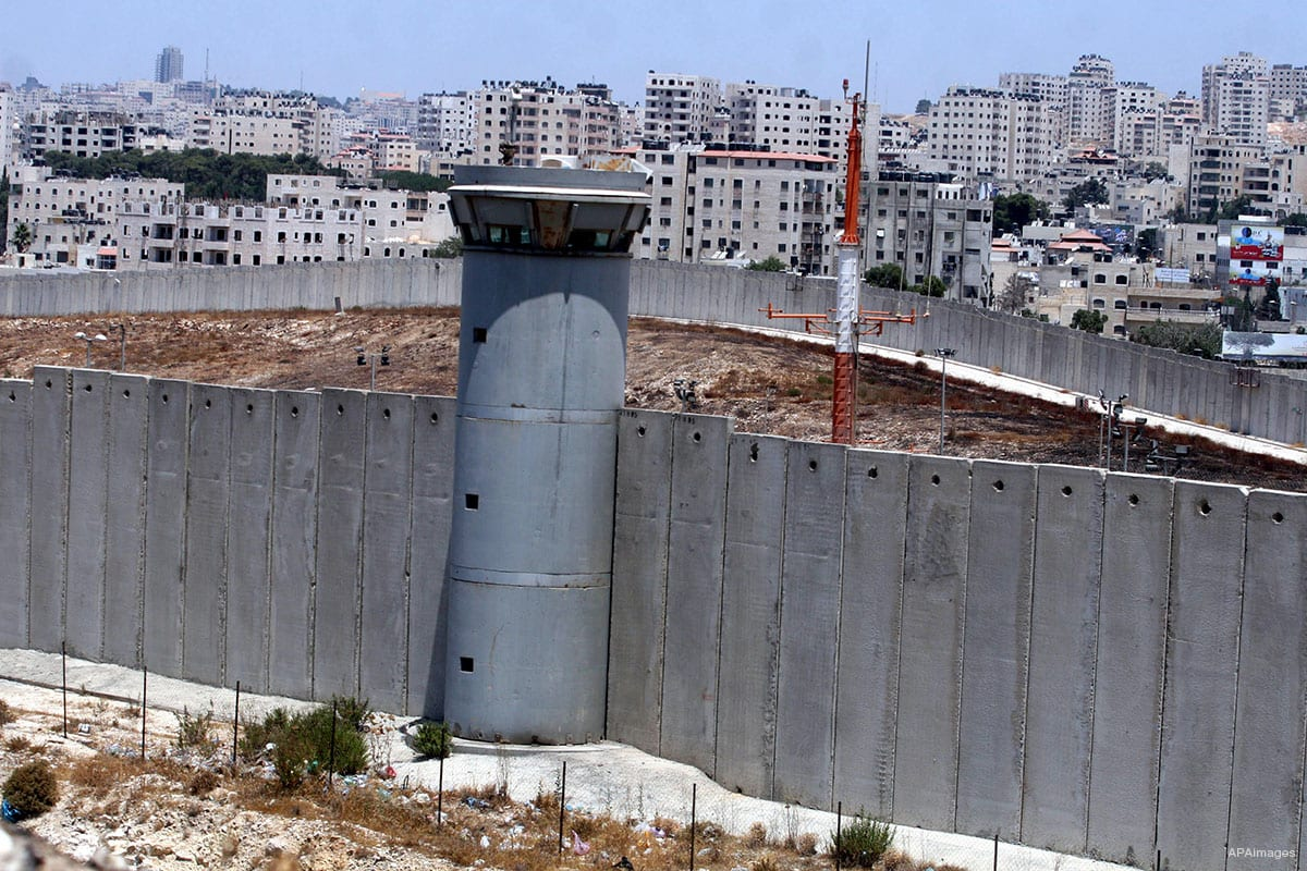A view of the Apartheid the wall in the West Bank which also shows an Israeli military watchtower