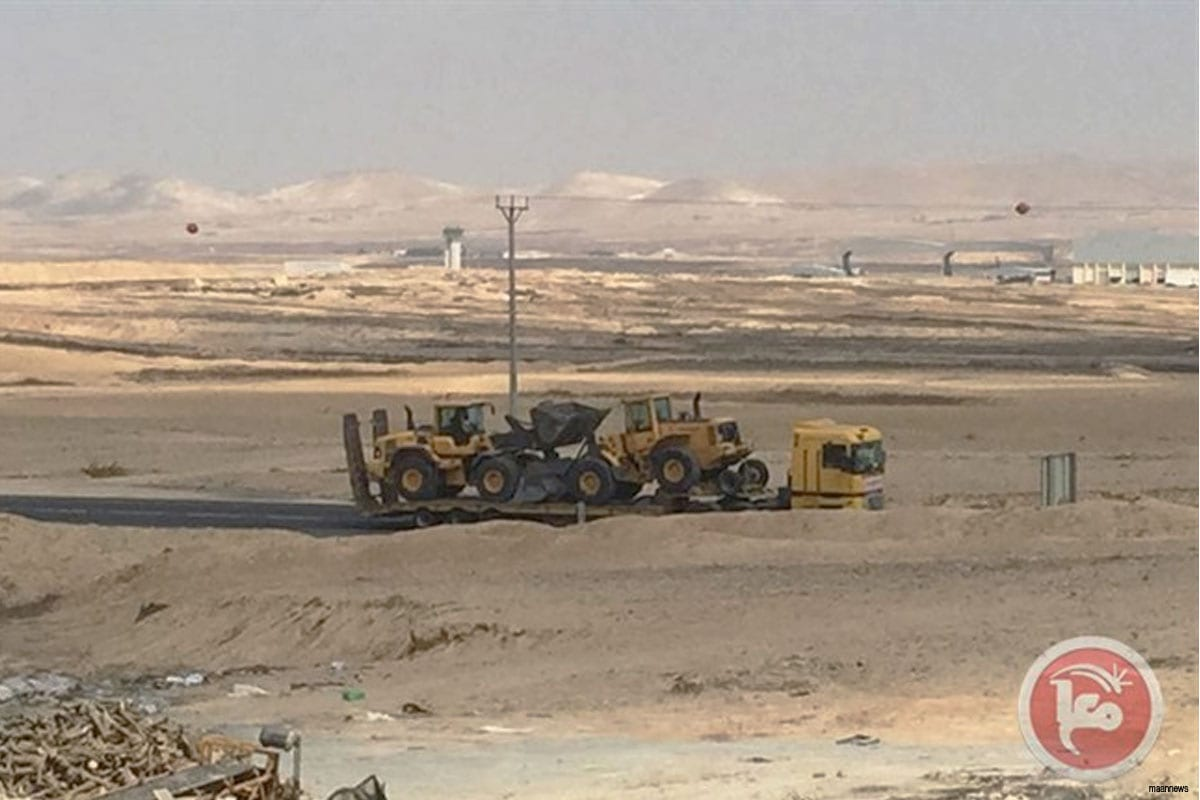 Israeli bulldozers being transported to a Palestinian village in the Negev [August 2016]