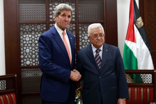 Palestinian President Mahmoud Abbas (R) shakes hands with US Secretary of State John Kerry (L) before their meeting at Abbas's Headquarter in Ramallah, November 24, 2015
