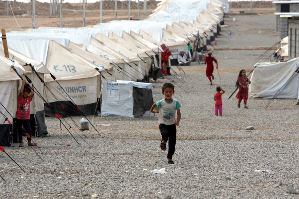 Displaced children, who fled from Daesh violence, are seen at Debaga Camp in the Makhmour area near Mosul, Iraq [Reuters/Azad Lashkari /File Photo]