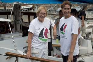 """BARCELONA, SPAIN - SEPTEMBER 14: Activists Ann Wright (L), member of the crew of Amal-Hope and Zaytouna-Oliva, with only female activists on board, poses before set off for the Gaza Strip from the port of Barcelona under the banner """"The Women's Boat to Gaza"""" to break the Israeli blockade on Gaza on September 14, 2016 in Barcelona, Spain. ( Albert Llop - Anadolu Agency )"""
