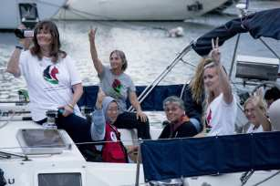 """Activists of Two sailing boats, Amal-Hope and Zaytouna-Oliva, with only female activists on board, make preparations before set off for the Gaza Strip from the port of Barcelona under the banner """"The Women's Boat to Gaza"""" to break the Israeli blockade on Gaza on 14 September, 2016 in Barcelona, Spain [Albert Llop/Anadolu Agency]"""