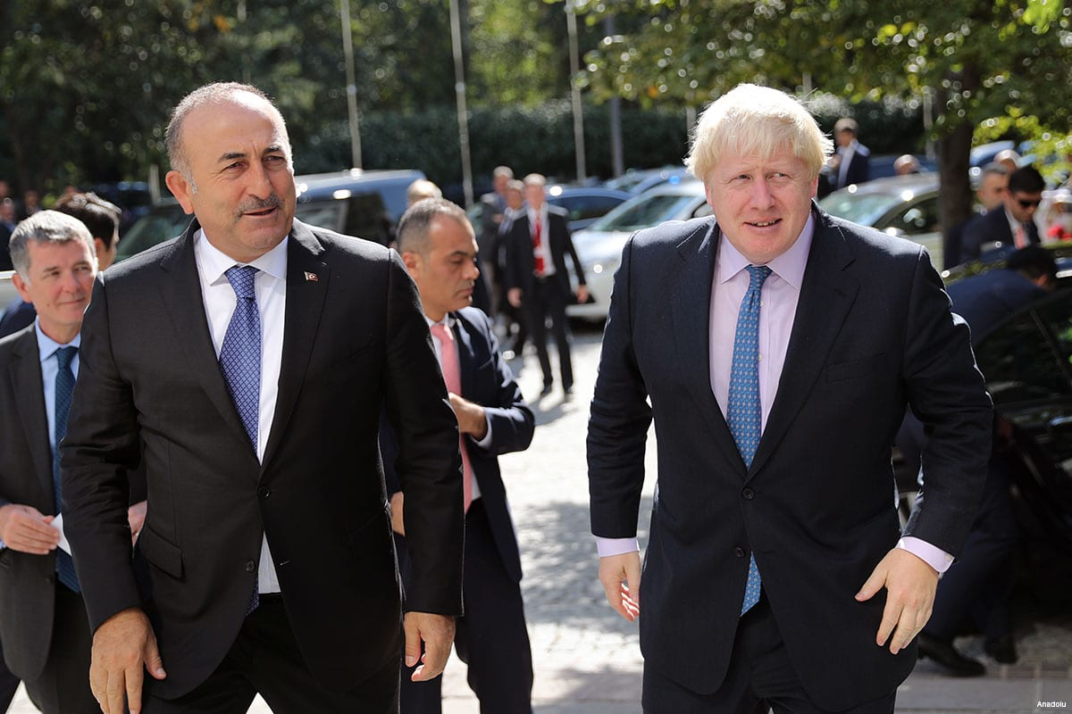 Turkish Foreign Minister Mevlut Cavusoglu (R) and his British counterpart Boris Johnson (L) attend an inter-delegations meeting in Ankara, Turkey on September 27, 2016
