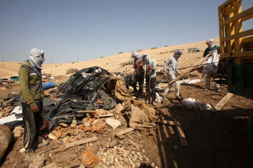 Palestinians inspect rubble of their homes after they were demolished by Israeli forces [ Nedal Eshtayah - Anadolu Agency]