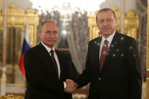 President of Turkey Recep Tayyip Erdogan (R) and President of Russia Vladimir Putin (L) shake hands during a press conference following their meeting at Mabeyn Palace in Istanbul, Turkey on 10 October 2016 [Metin Pala/Anadolu Agency]