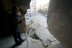 ALEPPO, SYRIA - OCTOBER 10: 60-years-old local resident, who lost his two sons and also his wife and his two daughters wounded in Assad regime forces' attacks, wander around his collapsed house, had been hit on 23th of last September, in Aleppo, Syria on October 10, 2016. Abu Hassan, used to be a merchant before the civil war, runs a grocery store under his heavily damaged house, nowadays. ( Jawad Al Rifai - Anadolu Agency )
