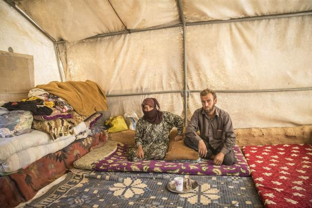 ALEPPO, SYRIA - OCTOBER 10: Internally displaced Syrians, fled from clashes as well as Daesh terrorists' and Assad Regime's attacks, stay at the makeshift camps near the border of Turkey between Al-Rai (Cobanbey) and Jarabulus Towns of Aleppo, Syria on October 10, 2016 as the civil war continues. Syrians from Aleppo's Umm `Amud village, has been hit by Assad Regime forces nearly 4 years ago, live in the secured zone to protect their families. ( Emin Sansar - Anadolu Agency )