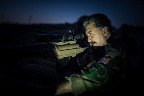 BASHIQA FRONTLINE IRAQ, AUGUST 7: General Hussein Yazdanpanah, leader of the Iranian based Kurdistan Freedom Party (PAK) is taking aim with a sniper rifle near Daesh held Bashiqa. (Photo: Alex Kühni)