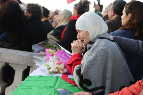 People gather during a commemoration ceremony on the Saint-Michel Bridge, to commemorate the victims of the 17 October 1961 massacre, in Paris on October 17, 2016 [Mustafa Sevgi/Anadolu Agency]