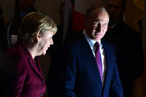 BERLIN, GERMANY - OCTOBER 19: German Chancellor Angela Merkel (L) meets with President of Russia Vladimir Putin (R) for the summit on Ukrainian and Syrian issues where Normandy Four Leaders participate at Chancellery in Berlin, Germany on October 19, 2016.   ( Maurizio Gambarini - Anadolu Agency )