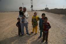 Civilians are seen as the Iraqi Army and Hashd al-Shaabi militias arrive at Saleh Village after retaking of Khalid, Saleh and Zanawer Villages of Qayyarah Town from Daesh terrorists during the operation to retake Iraq's Mosul from Daesh terrorists, in Mosul, Iraq on October 20, 2016. The operation to retake Iraq's Mosul from Daesh terrorists continues. [Hemn Baban/Anadolu Agency]