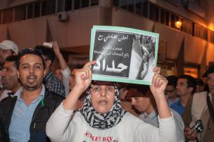 RABAT, MOROCCO - OCTOBER 30: Moroccan people stage a protest in front of Internal Ministry in Rabat, Morocco, after a fisherman Mohcine Fikri, was crushed to death in a garbage truck. ( Jalal Morchidi - Anadolu Agency)