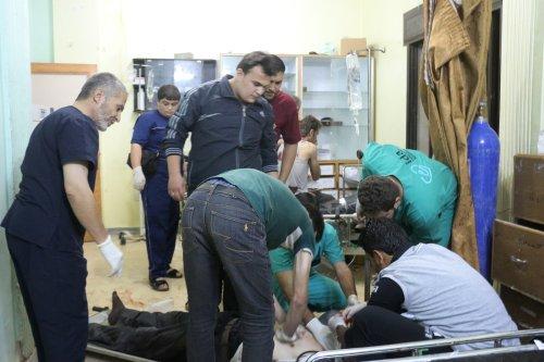 Image of medical staff treating civilians in Aleppo, Syria [Mamun Ebu Ömer /Anadolu Agency]