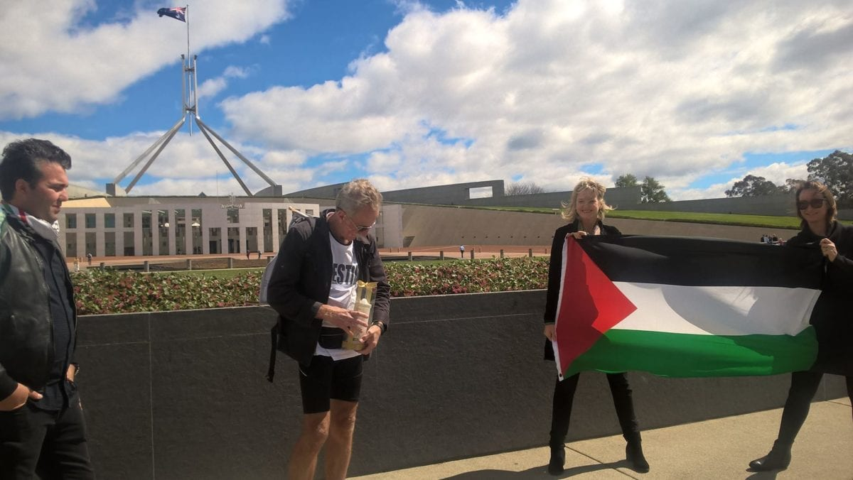 John Salisbury of the Recognise Palestine Walk reaches Parliament House, Canberra, after a week of walking through Australia [Facebook/Jessica Morrison]