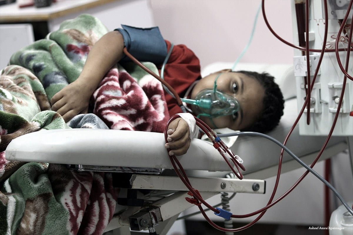 A Palestinian boy receives dialysis treatment at a hospital in Gaza on November 11 2013 [Ashraf Amra/Apaimages]