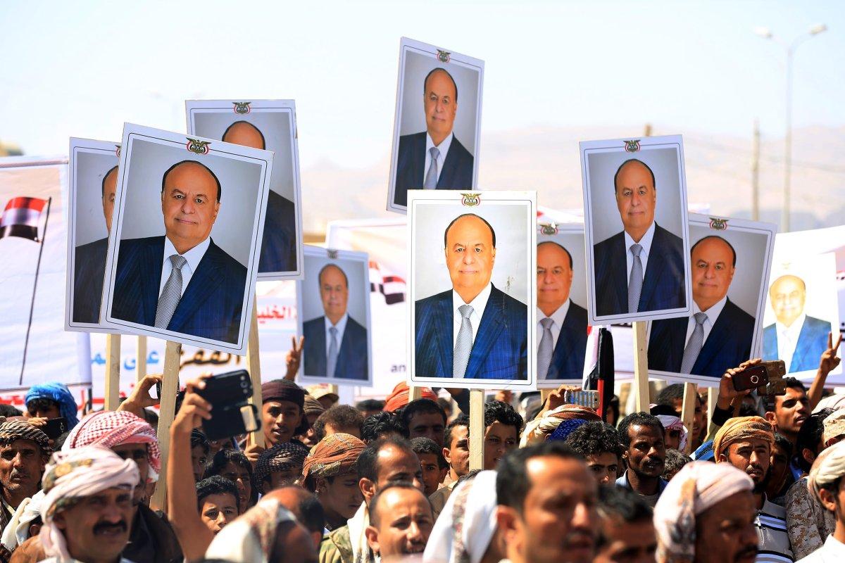 Supporters hold portraits of Yemeni President Abd Rabbuh Mansur Hadi during a protest in Ma'rib, Yemen on 3 November, 2016 [Ali Owidha/Anadolu Agency]