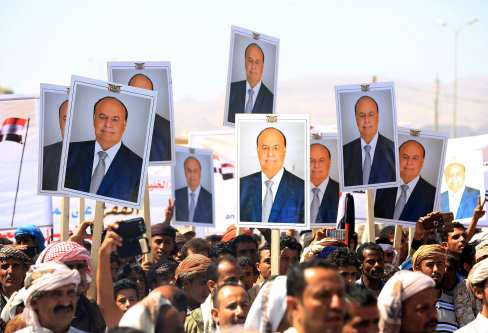 Supporters hold portraits of Yemeni President Abd Rabbuh Mansur Hadi during a protest in Ma'rib, Yemen on 3 November, 2016 [Ali Owidha/Anadolu Agency]