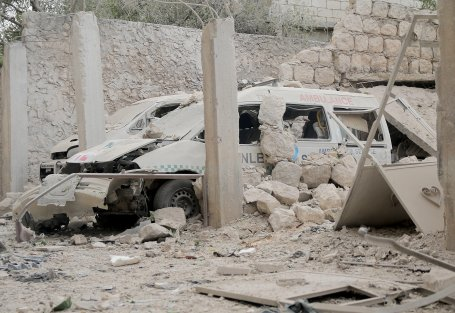 IDLIB, SYRIA - OCTOBER 13: Damaged ambulances are seen after an airstrike targeted a medical center in Binnis district of Idlib, Syria on October 13, 2016. ( Firas Faham - Anadolu Agency )