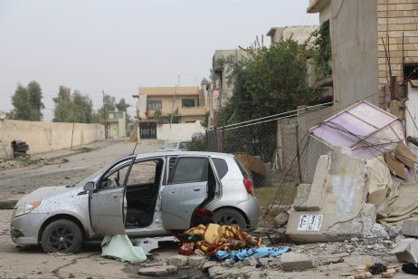MOSUL, IRAQ - NOVEMBER 16: Wreckage of vehicles are seen on the street in the Zahra neighborhood of Mosul, Iraq on November 16, 2016 as the operation to liberate Mosul from Daesh terrorists continue. ( Hemn Baban - Anadolu Agency )