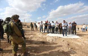 JERICHO, WEST BANK - NOVEMBER 17: Palestinian protesters perform prayer during a demonstration at the symbolic region named 'Yasser Arafat Village' in Al-Agvar region of Jericho, West Bank on November 17, 2016. ( Issam Rimawi - Anadolu Agency )