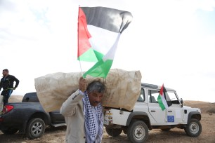 JERICHO, WEST BANK - NOVEMBER 17: Palestinian protesters set up a symbolic village to protest Israel near al-Hamma and Ayn al-Beyza regions where the Bedouins live in Al-Agvar of Jericho, West Bank on November 17, 2016. ( Issam Rimawi - Anadolu Agency )
