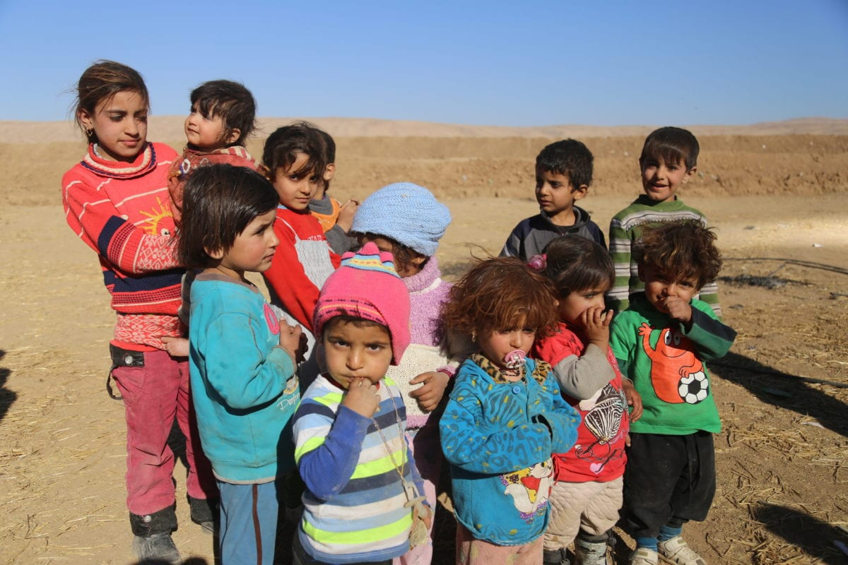 Iraqi children wait to be placed in refugee camps after escaping the violence in Mosul on 20 November 2016 [Feriq Fereç/Anadolu Agency]