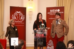 Jehan Bseiso (poet) and David Borrington (illustrator) collect an award for their work on the poetry book 'I Remember My Name', at the Palestine Book Awards 2016 [Middle East Monitor]