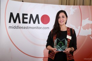 Jehan Bseiso is seen with her award at the Palestine Book Awards 2016 [Middle East Monitor]