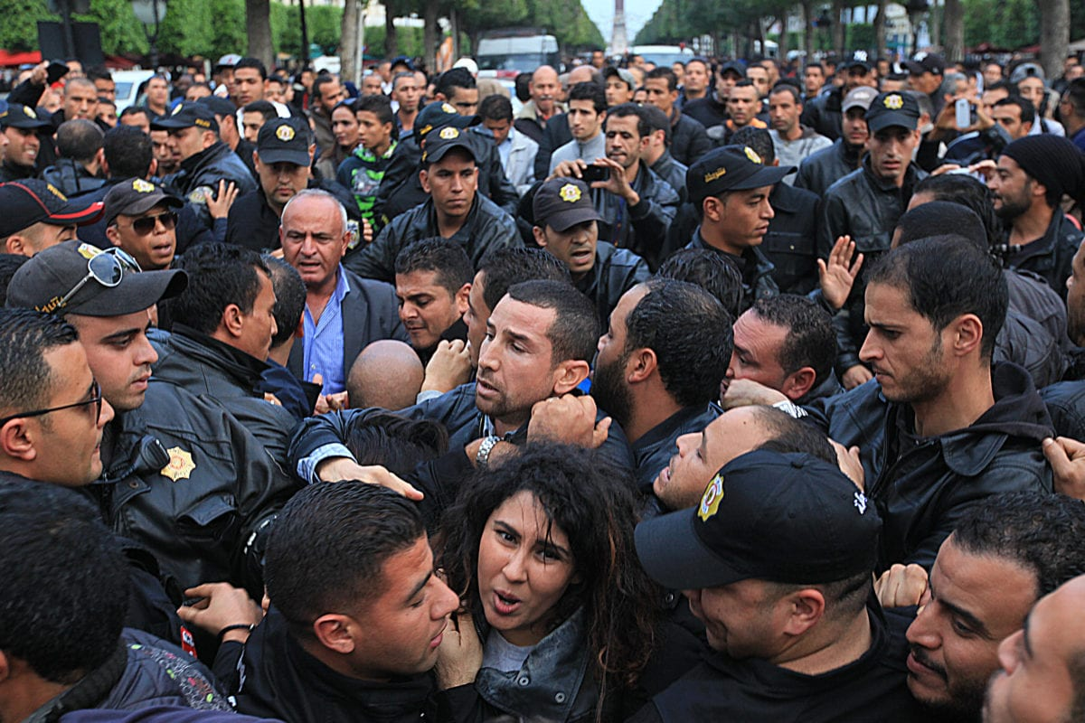 Unemployed university graduates argue with the security forces during a demonstration held to demand job opportunities, in Tunis, Tunisia on November 24 2016 [Yassine Gaidi/Anadolu Agency]