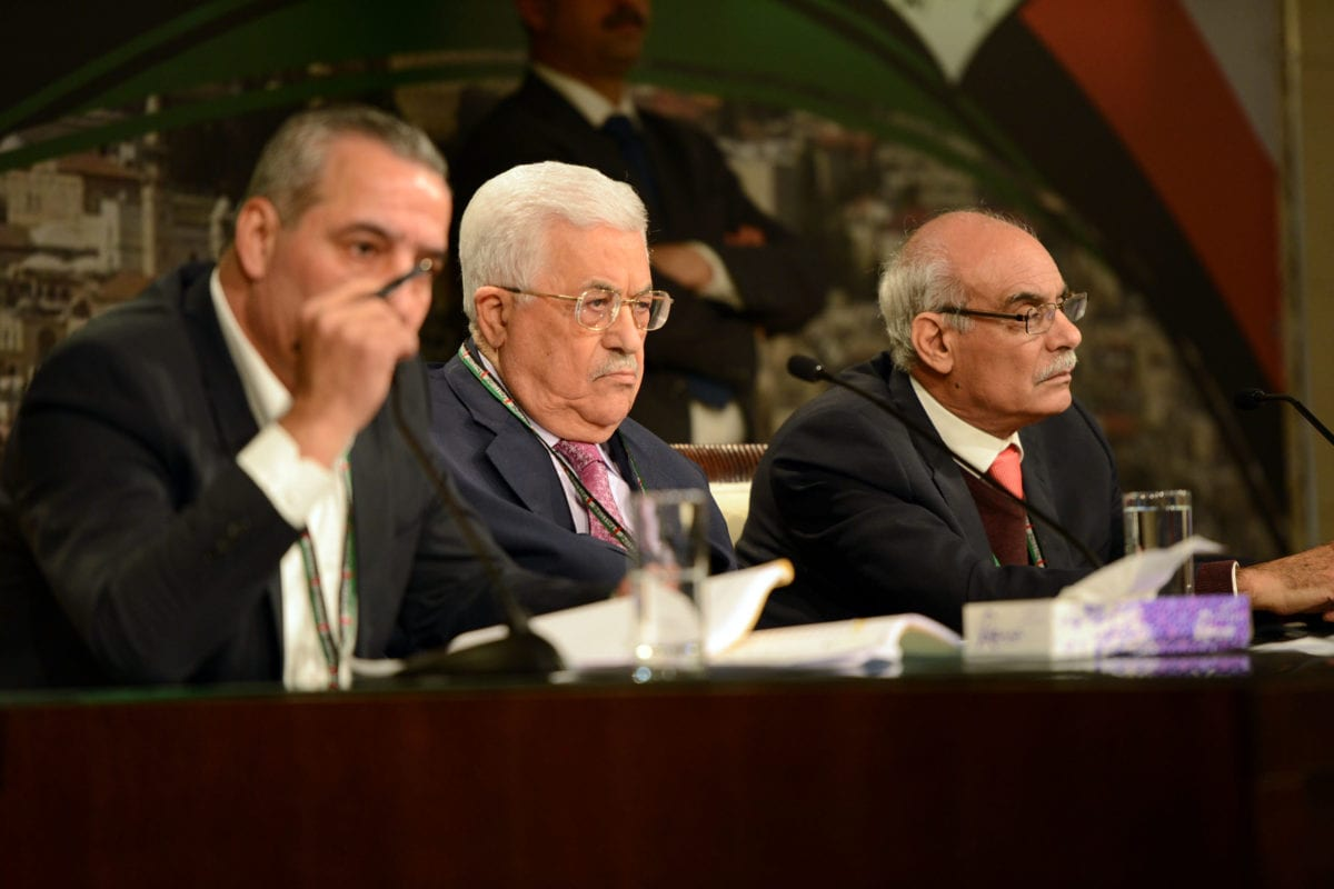Palestinian President Mahmoud Abbas (C) attends the 7th General Assembly meeting of Fatah Movement in Ramallah, West Bank on November 29 2016 [Palestinian Presidency / Handout / Anadolu Agency]