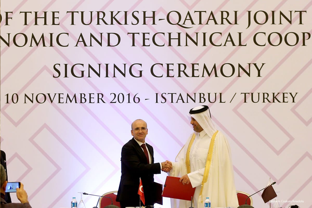 Turkish Deputy Prime Minister Mehmet Simsek (L) and Qatari Minister of Economy and Commerce Sheikh Ahmed Bin Jassim al-Thani (R) attend the 6th Session of the Turkish-Qatari Joint Commission on Economic and Technical Cooperation Signing Ceremony in Istanbul, Turkey on 10 November 2016 [Şebnem Coşkun/Anadolu]