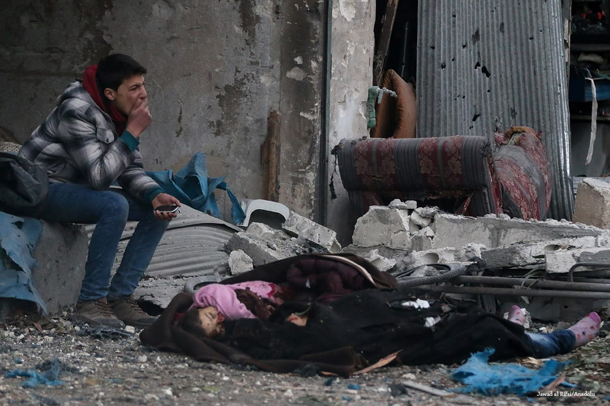 A Syrian man cries near a dead body of a girl after the Assad Regime forces carried out airstrikes in Aleppo, Syria on November 30 2016 [Jawad al Rifai/Anadolu]