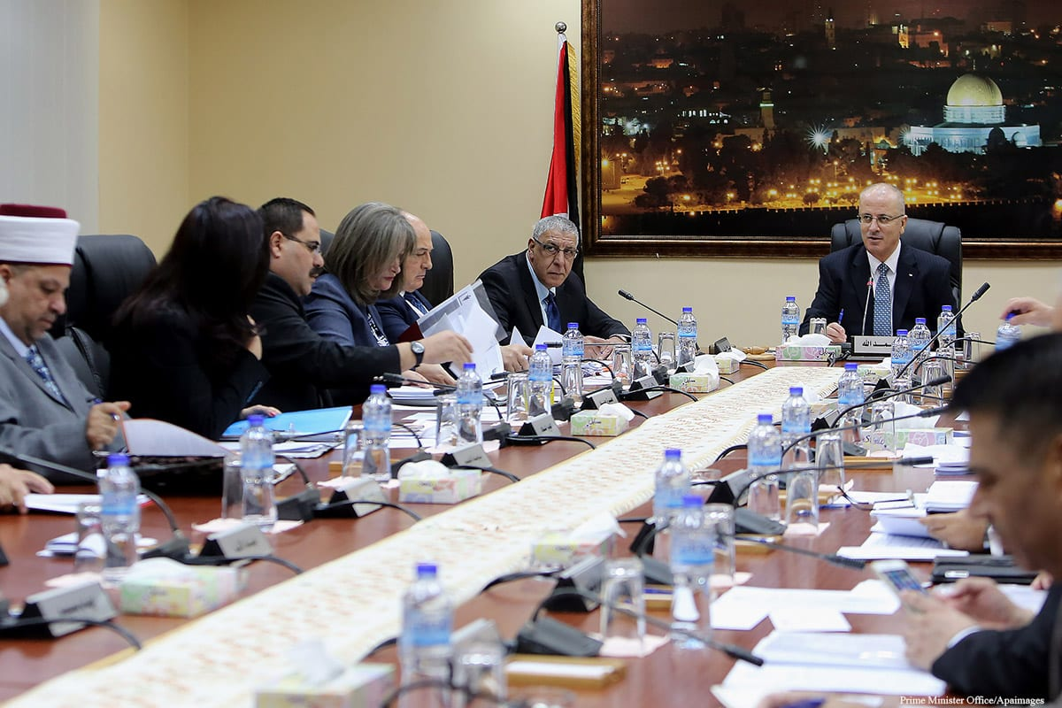 Palestinian Prime Minister, Rami Hamdallah, chairs a meeting with the Council of Ministers, in the West Bank on October 18 2016 [Prime Minister Office/Apaimages]