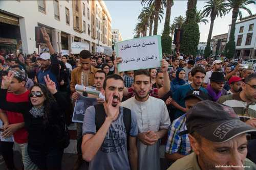 Moroccan people stage a protest after a fisherman, Mohcine Fikri, was crushed to death in a garbage truck, in Morocco on October 30 2016 [Jalal Morchidi/Anadolu Agency]