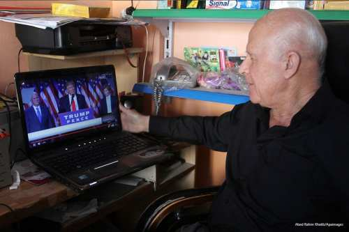 Palestinian man watches Donald Trump's victory speech on 9th November 2016 [Abed Rahim Khatib/Apaimages]