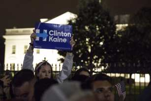 WASHINGTON, USA: A supporter holds up a sign in support of Hillary Clinton in a crowd of Clinton and Trump supporters that has gather in front of the White House as the results of the 2016 Presidential Election became clear in Washington, USA on 9 November 2016. [Samuel Corum/Anadolu Agency]