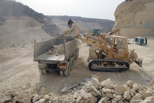 Image of labourers working at a quarry in the West Bank [Najeh Hashlamoun/Apaimages]