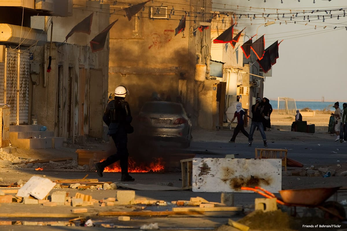 Image of Bahrain police and protesters [Friends of Bahrain/Flickr]