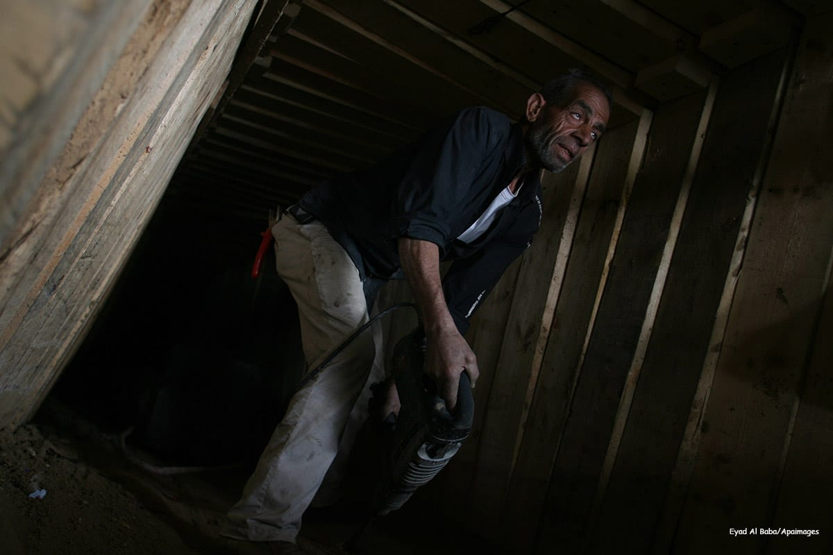 Image of a Palestinian man inside a smuggling tunnel, beneath the Egyptian-Gaza border on February 19 2013 [Eyad Al Baba/Apaimages]
