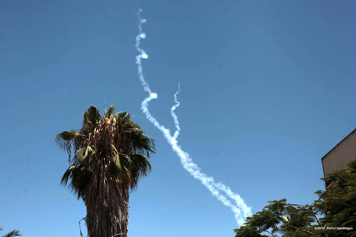 Image of smoke trails from launched rockets by Israel [Ashraf Amra/Apaimages]