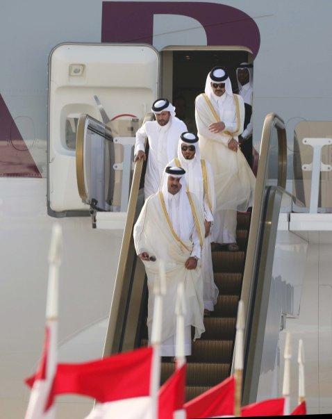 MANAMA, BAHRAIN - DECEMBER 6: Emir of Qatar, Sheikh Tamim bin Hamad Al Thani steps out of a plane upon his arrival at Sakhir Air Base in Manama, Bahrain on December 6, 2016. King of Saudi Arabia, Salman bin Abdulaziz Al Saud will attend the Gulf Cooperation Council member states preparatory meeting. ( Stringer - Anadolu Agency )