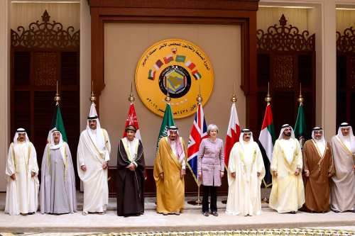 Leaders pose for a photo during the closing session of the 37th Leaders Summit by Gulf Cooperation Council member states at Al-Sakhir Palace in Manama, Bahrain on December 7 2016 [Stringer /Anadolu Agency ]