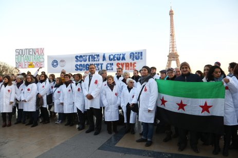 PARIS, FRANCE - DECEMBER 8: Members of the World Doctors association stage a protest, condemning massacres and attacks in Syria's Aleppo over civilians within the on going civil war at the Trocadero square close to the Eiffel Tower in Paris, on December 8, 2016. ( Mustafa Sevgi - Anadolu Agency )