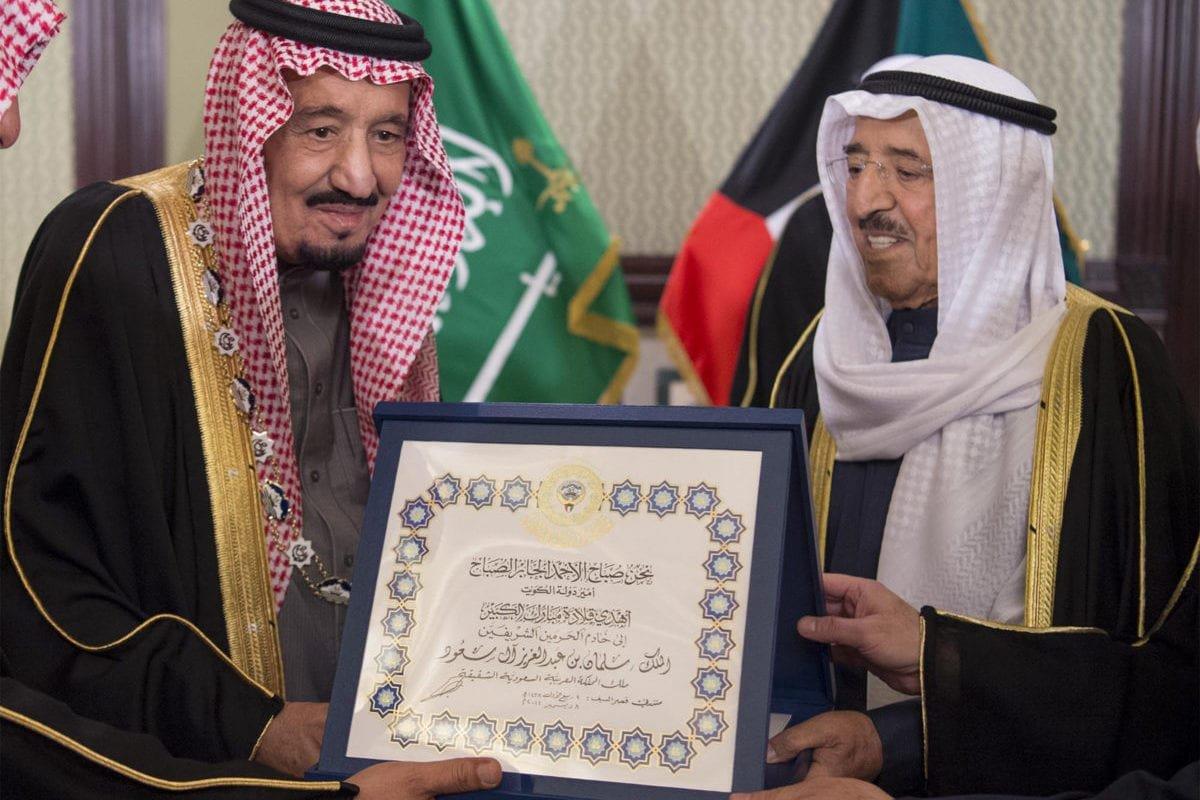 King of Saudi Arabia, Salman bin Abdulaziz Al Saud (L) receives the Order of Mubarak the Great from Emir of Kuwait, Sheikh Sabah IV Ahmad Al-Jaber Al-Sabah (R) in Kuwait City, Kuwait on December 8, 2016. [Bandar Algaloud / Saudi Royal Council / Handout - Anadolu Agency]