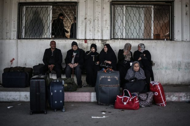 Palestinians wait at the Rafah Border crossing after the gate temporarily reopened in Gaza on December 10, 2016 [Ali Jadallah / Anadolu Agency]