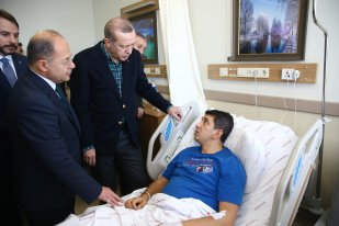 ISTANBUL, TURKEY - DECEMBER 11 : Turkish President Recep Tayyip Erdogan (3rd L) and Turkish Health Minister Recep Akdag (2n L) visit the injured police officers at Bezmialem Hospital in Istanbul, Turkey on December 11, 2016. ( Kayhan Özer - Anadolu Agency )